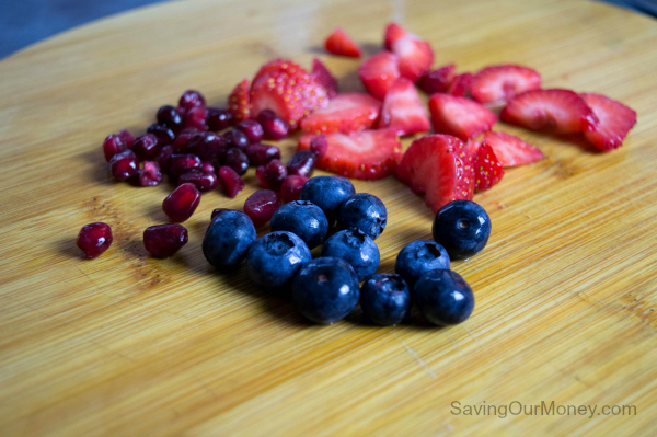 Strawberries, blueberries and pomegranate seeds for berry yogurt chia breakfast bowl